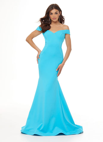 Ashley Lauren 11025 Exquisite fit and flare off the shoulder prom dress features a sweetheart neckline and our signature criss cross strappy back. The pageant gown is complete with a sweep train.  Colors Red, Turquoise, Hot Pink  Sizes  0, 2, 4, 6, 8, 10, 12, 14, 16,  Scuba Off Shoulder Fitted Criss Cross Back