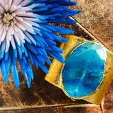 Gold leather cuff with gold edged blue agate