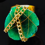 Gold plated cuff with chain wrapped green slab agate
