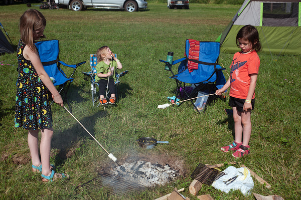 family camping at oshkosh with fire pit