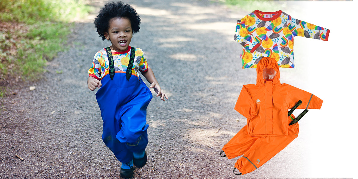 Child in CeLaVi outerwear and Bunting Tree rainbow top running on trail by Biddle and Bop