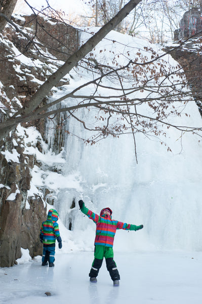two children in front of frozen waterfall in NJ in Villervalla Winter Gear from US Biddleandbop.com