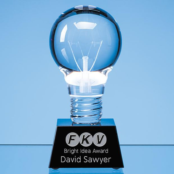 EUR144P -   6.5cm Dia Optical Crystal Lightbulb Award Mounted on an Onyx Black Crystal Base - (Fully Engraved)