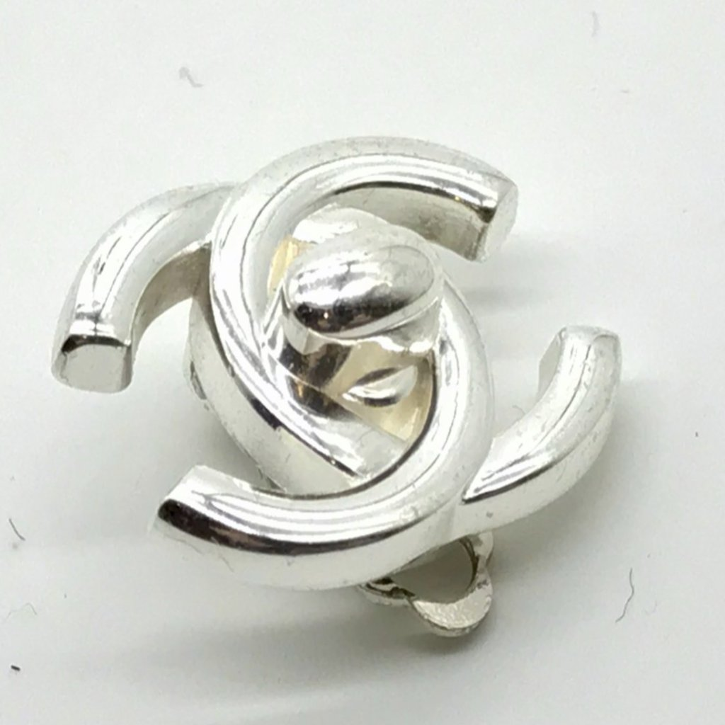 chanel silvertone turnlock earrings