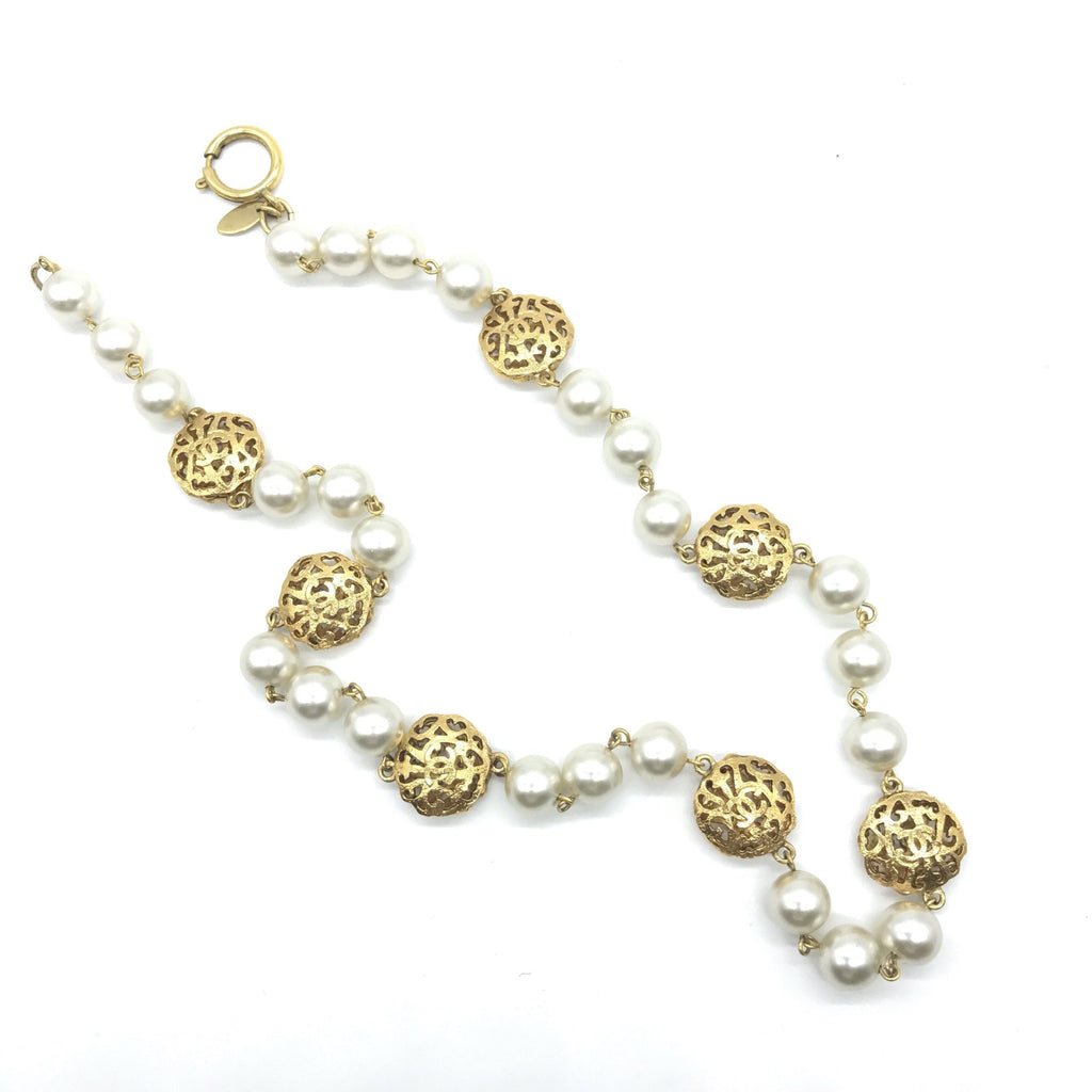 chanel pearl necklace with fretwork charms