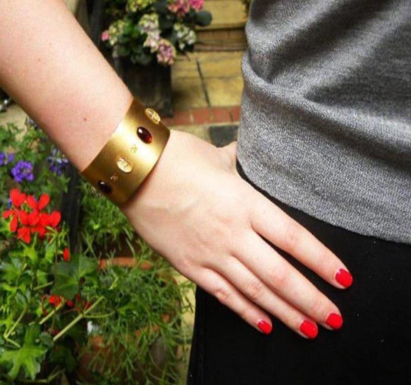chanel cuff in brushed gold on wrist