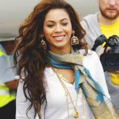 beyonce with Chanel birdcage earrings