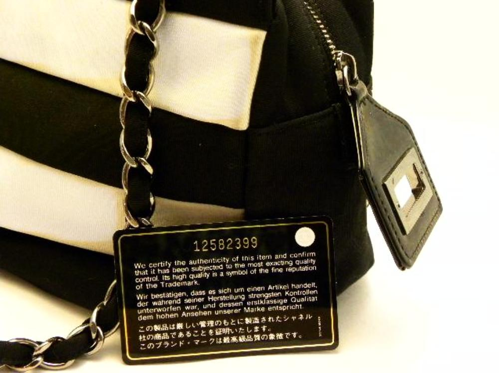 chanel black/white purse identity card