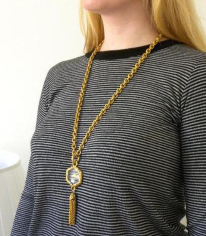 chanel loupe with tassel necklace
