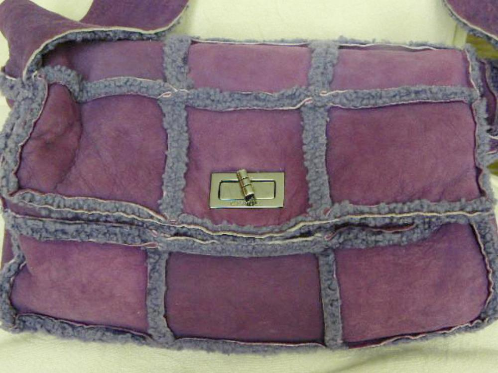 chanel handbag in violet sheepskin closeup