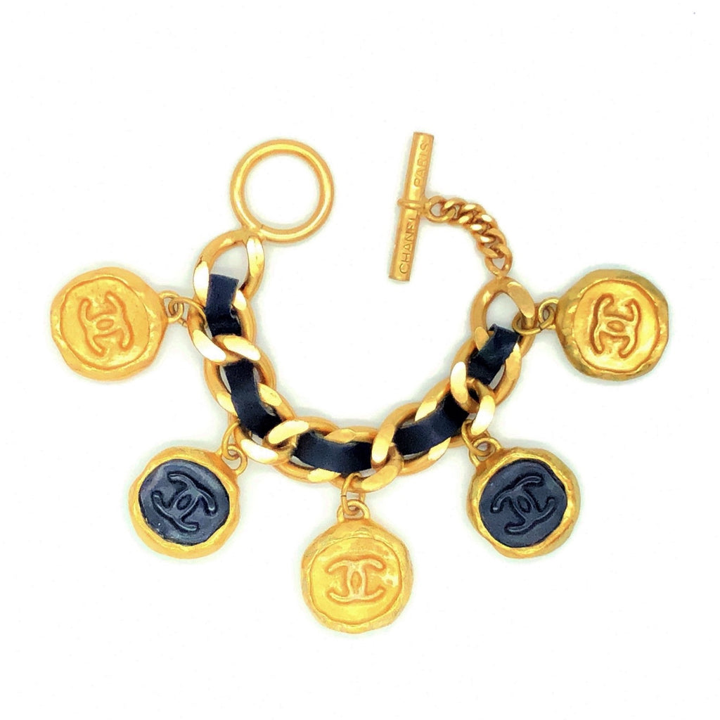 vintage chanel leather weave bracelet with charms