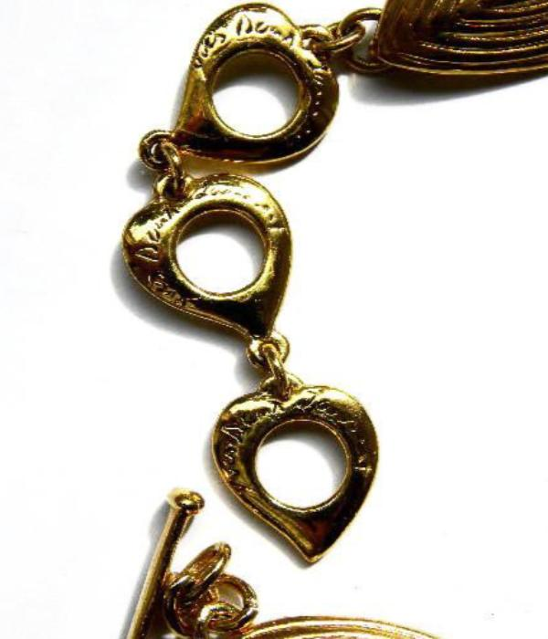 YSL etched oval necklace set clasp