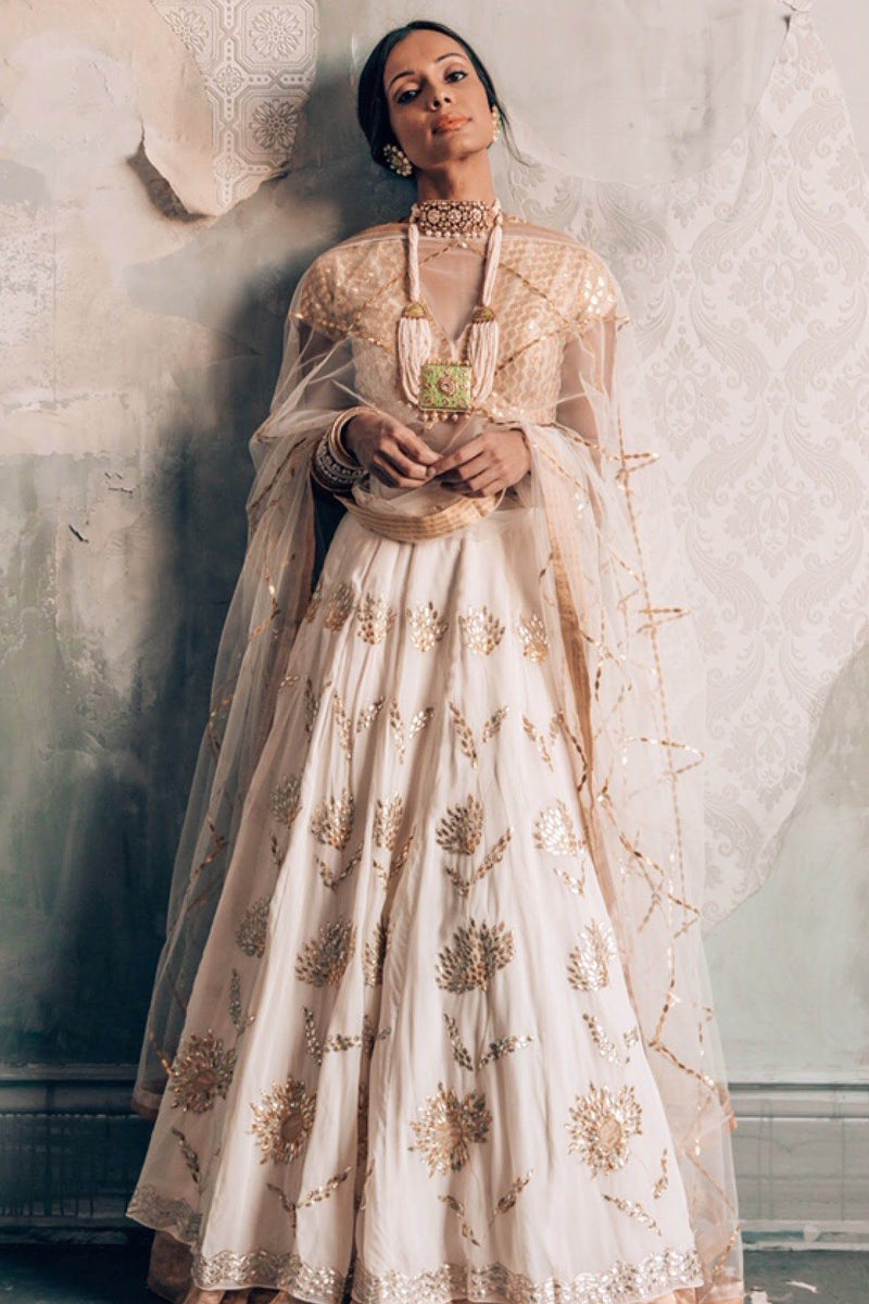 Huda Alvi In Ivory Lehenga with Golden Blouse