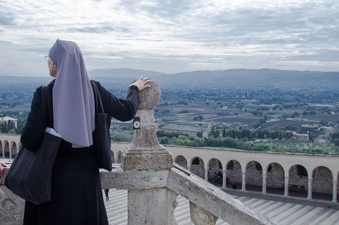 Nun overlooking Assisi's Panorama