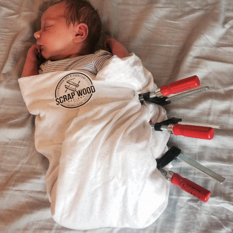 Baby swaddled with wood clamps. Adorable!