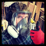 David wearing a full mask respirator in the shop.  Safety first!