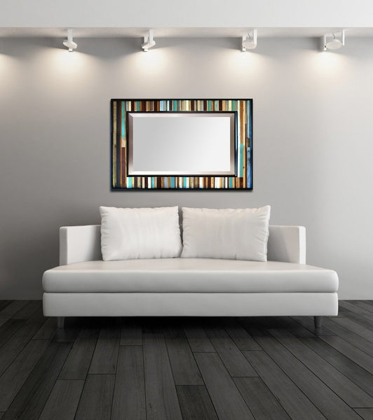 Blue and brown reclaimed wood mirror above white couch