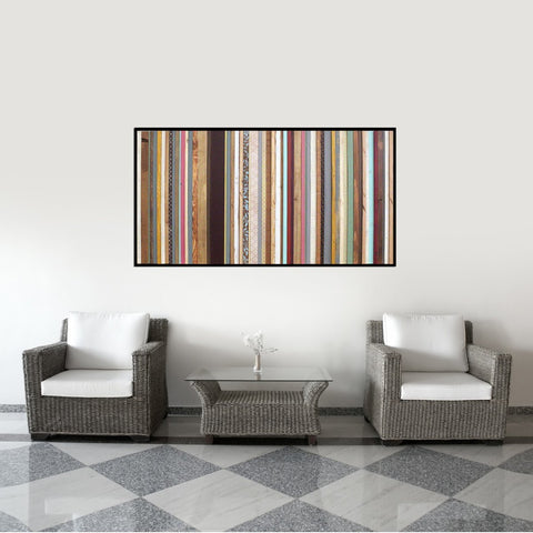 Arabian Nights wood wall art above white chairs