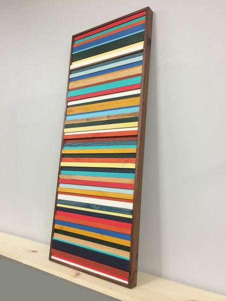 Brighton red, blue, and yellow wood wall art vertical angle