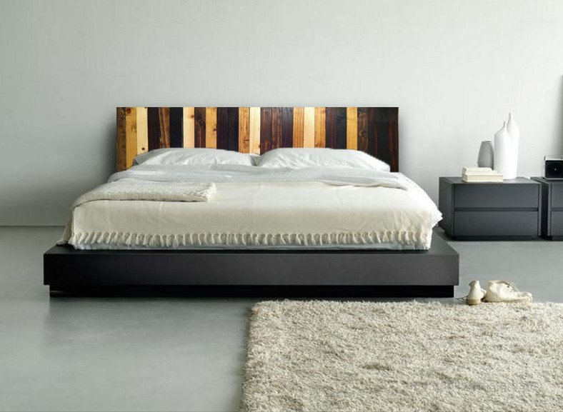 Rustic brown reclaimed wood headboard above bed.