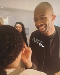 NARS Melrose Boutique Artist EJ touching up in the Vanity Girl Hollywood mirror at the Women in Leadership Awards 2019