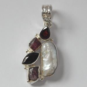 Alternate Lighting on Garnet and Pearl Pendant, set in sterling silver