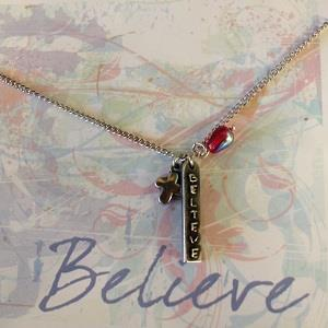 Close up view of Believe necklace in greeting card