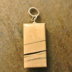 mammoth ivory impressions double-sided pendant mammoth ivory side