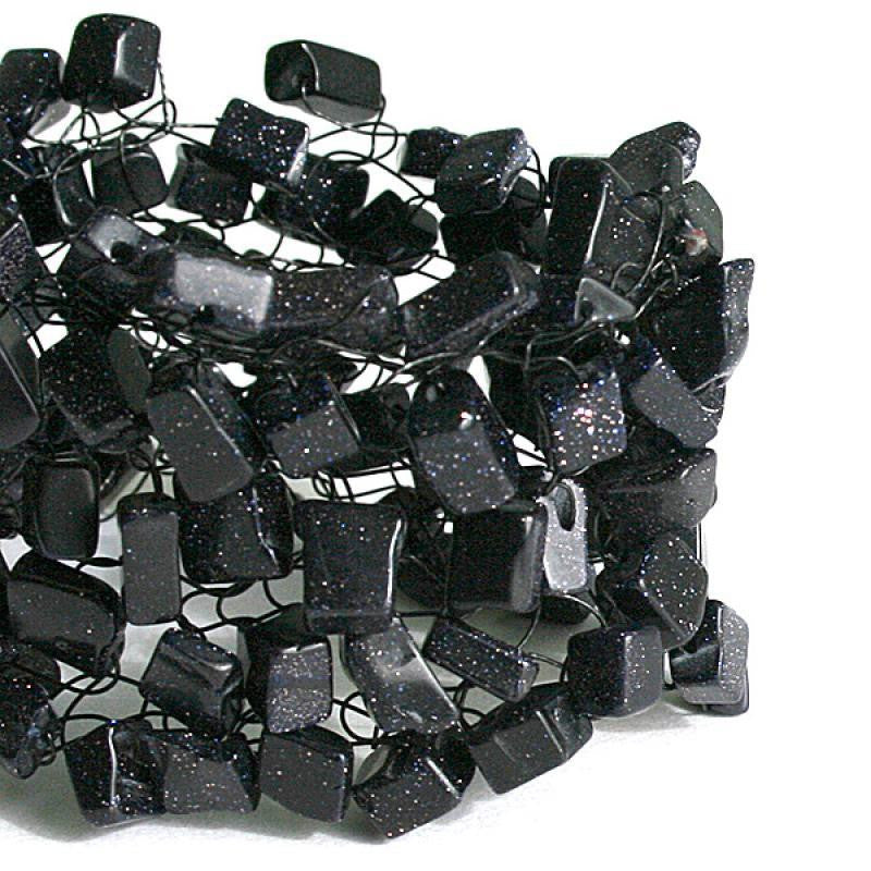 """black"" is made of blue goldstone chips"