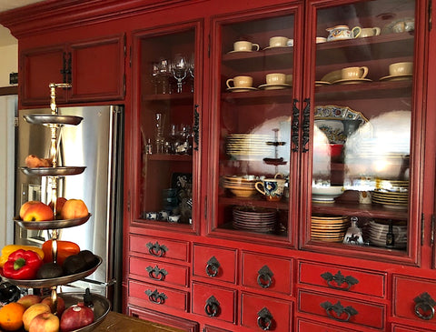 hand made custom kitchen with drawers and antique spanish hardware in red lacquer