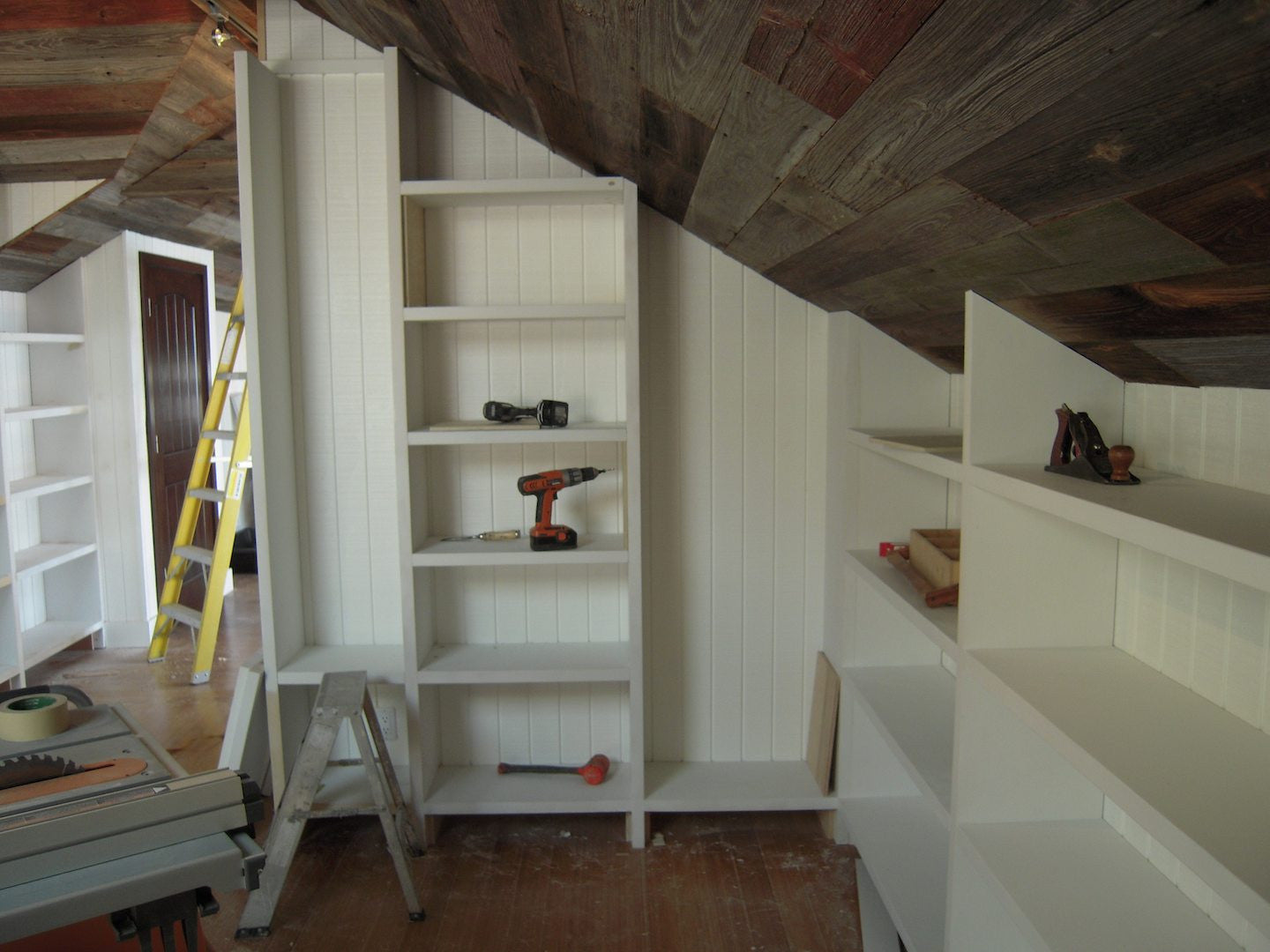 Builtin Bookcase and Salvaged Barn Wood Ceiling in Malibu