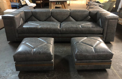 custom diamond tufted sofa with leather and brass ottomans