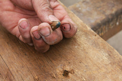 We Found an Old Bullet in Salvaged Lumber From a Church