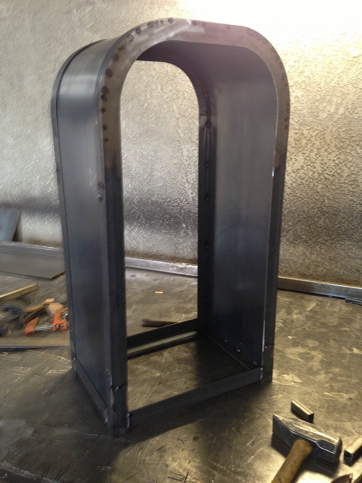 building the metal frame of the theme park inspired trash can