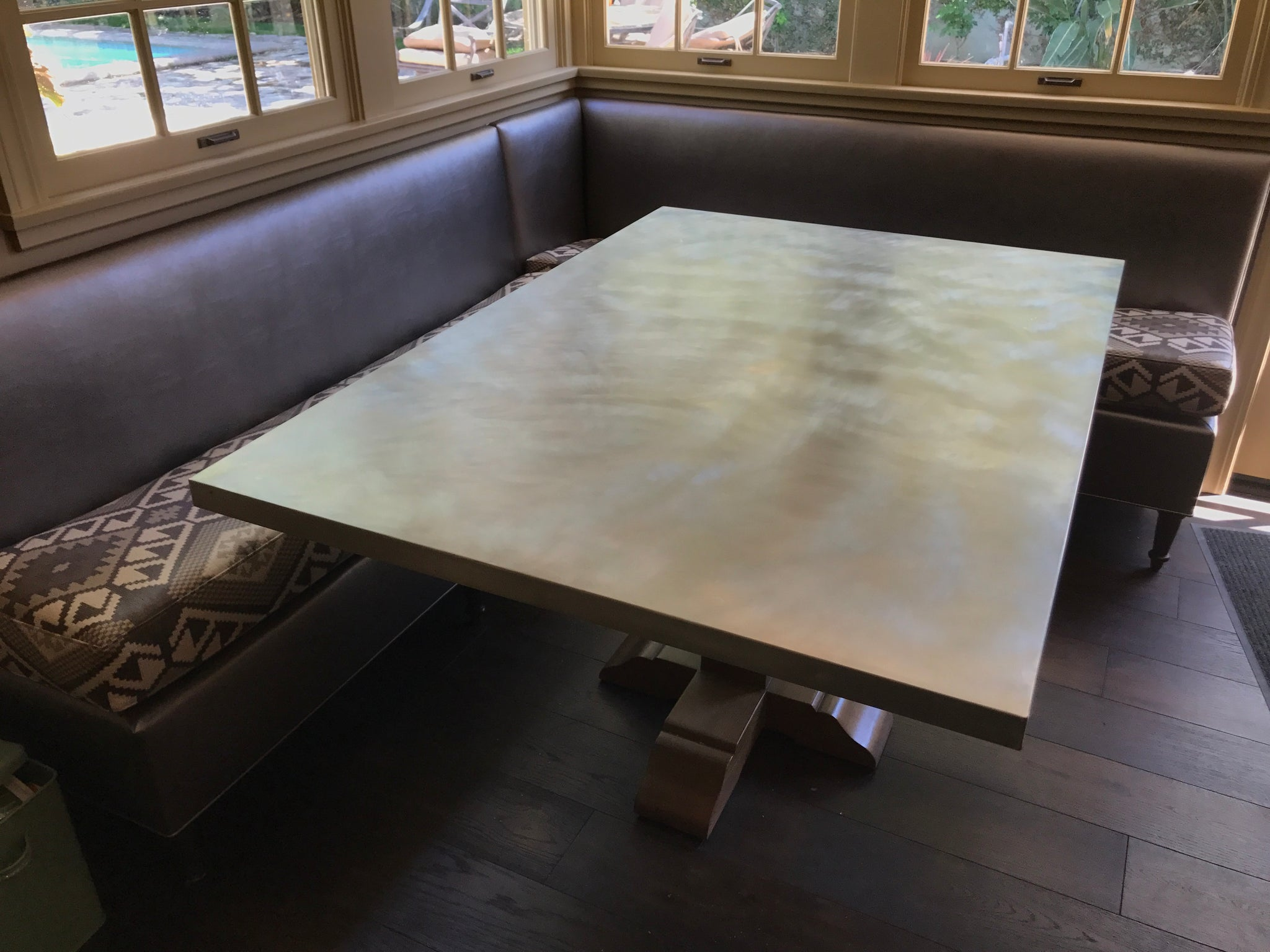 Upholstered Banquette and Zinc Top Pedestal Table