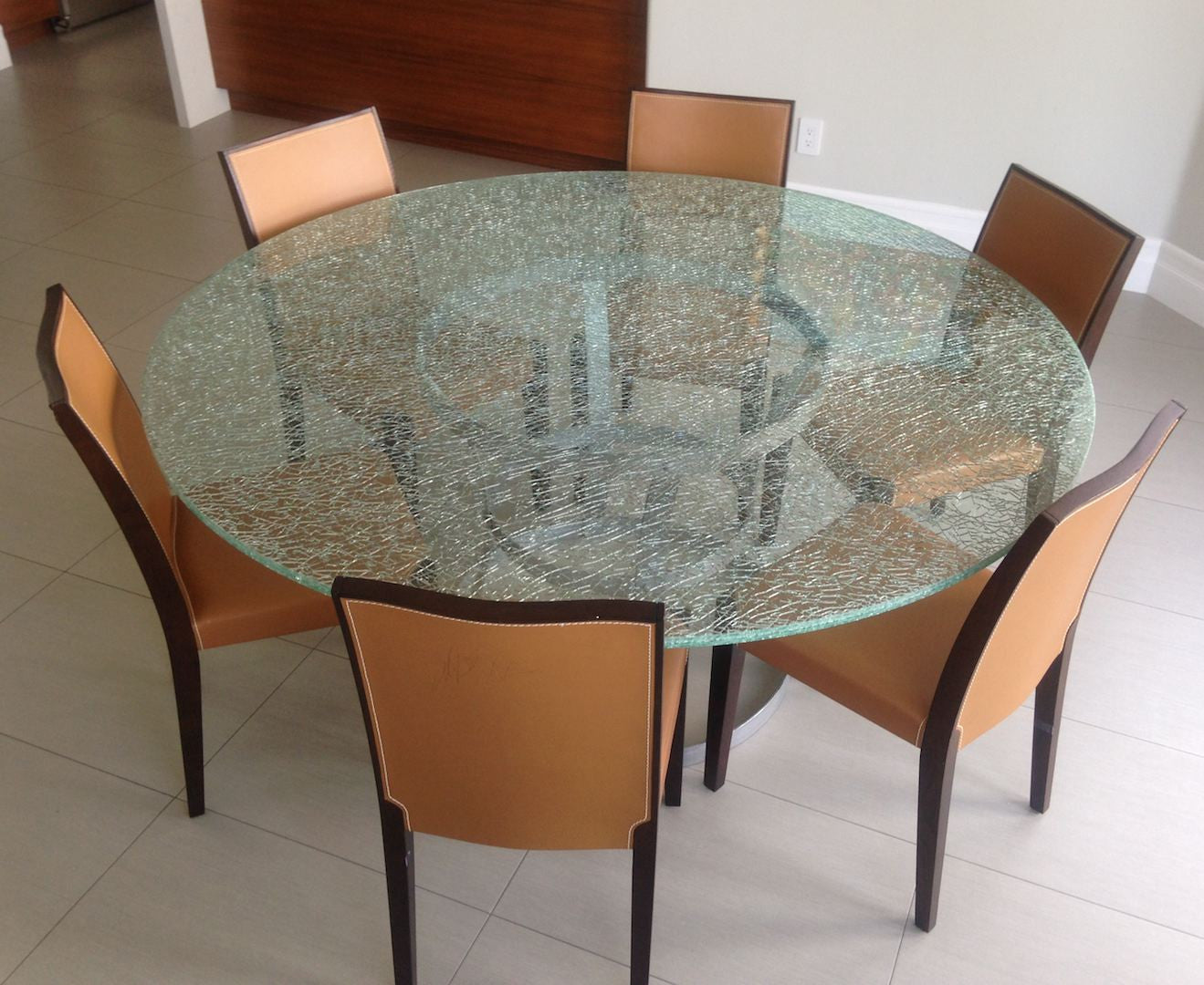 Picture of: Round Crackle Glass Dining Table With Tripod Metal Base Mortise Tenon