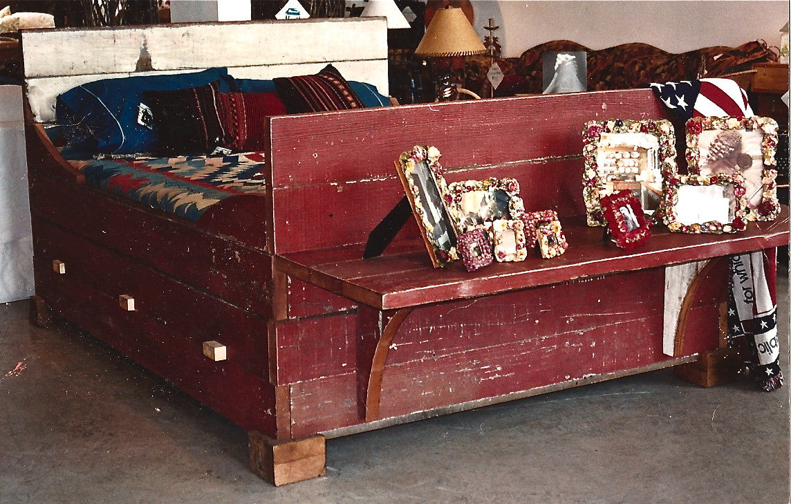One of our eariest salvaged wood designs. Custom queen size barn bed with footboard desk