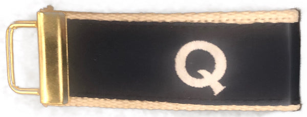 Q Custom Ribbon Fob On Oatmeal