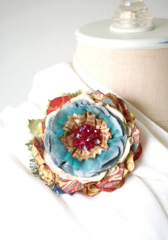 red and turquoise fabric flower pin