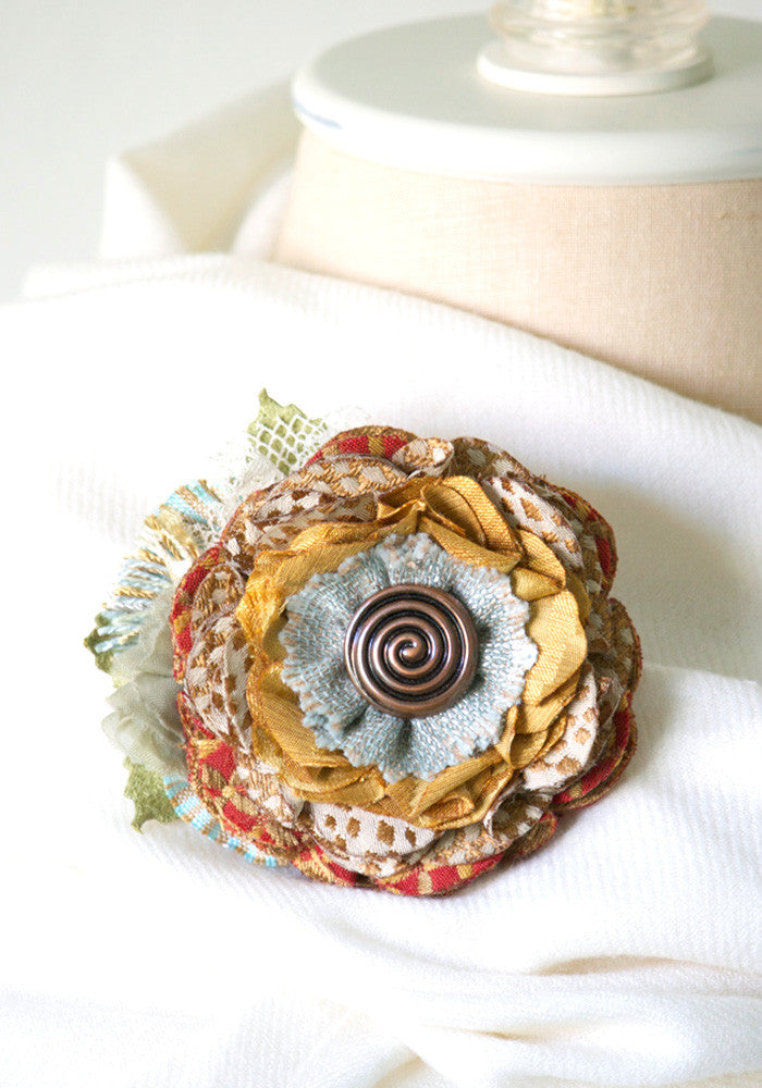 floral button brooch
