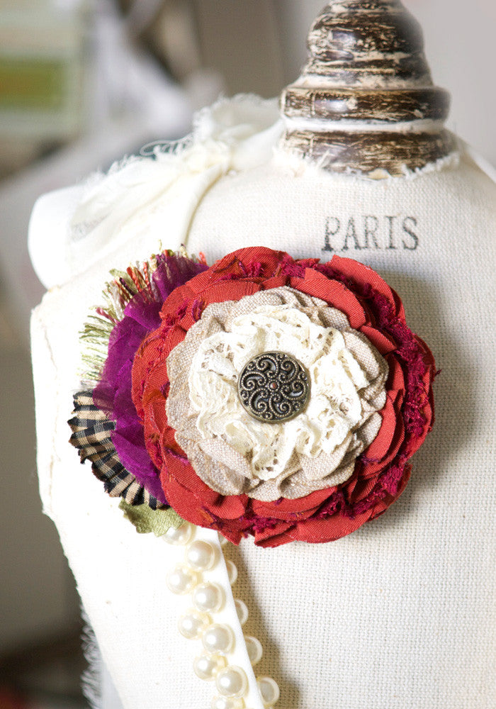 red fabric flower pin