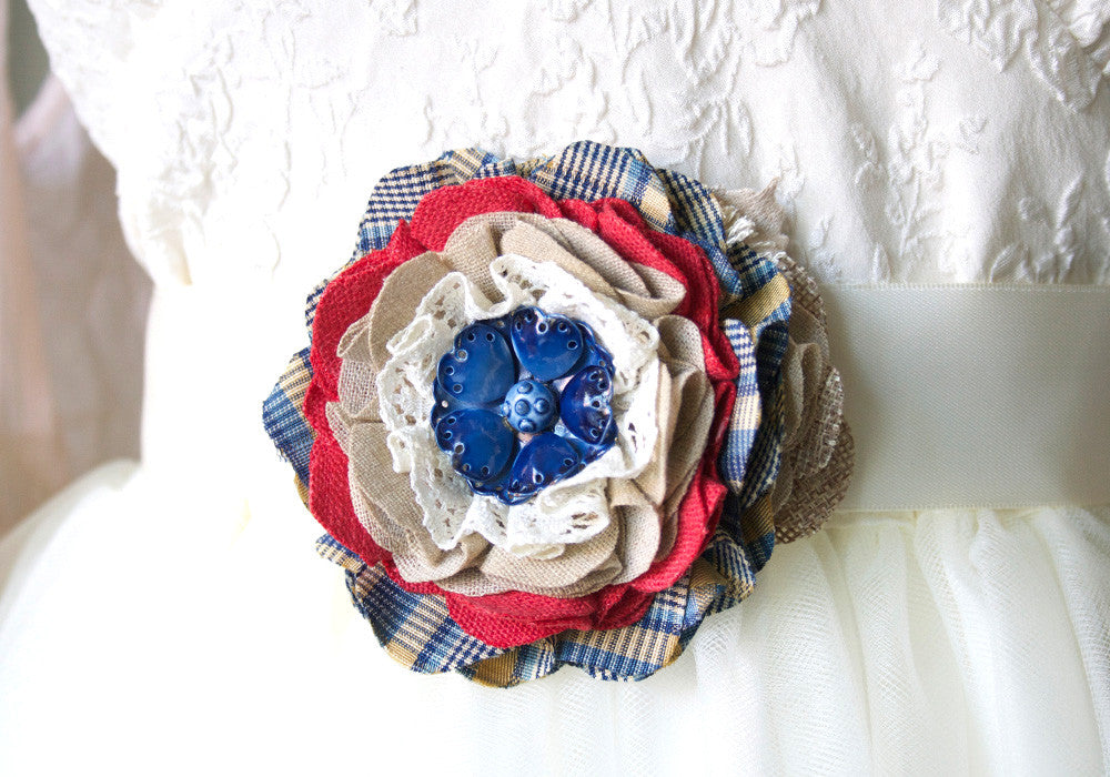 red white and blue fabric flower pin