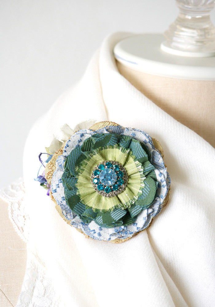 fabric flower brooch in blue and green