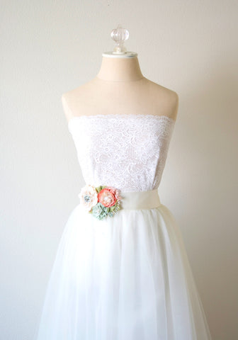 floral sash on dress