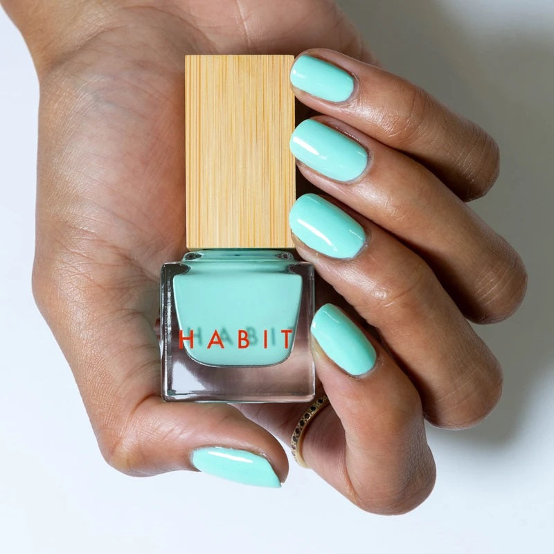 Bright light turqouise coloured nails. The nail polish is from Habit Cosmetics and the color is one of their new Sprin/Summer 2021 colors.