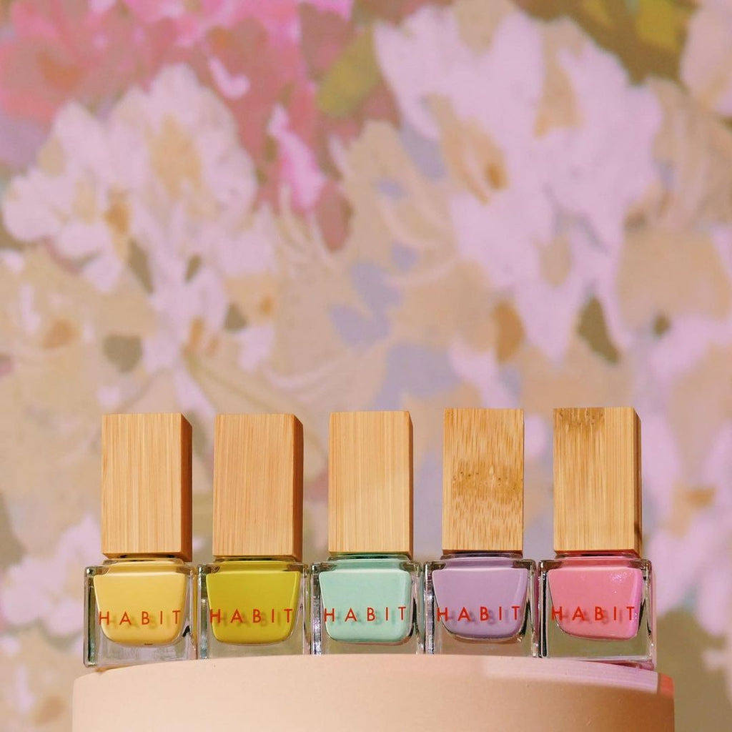 5 nail polishes in bright, spring and summer colors. They have a wooden bamboo overcap. These are Habit Cosmetics nail polishes, new 2021 spring and summer colors.