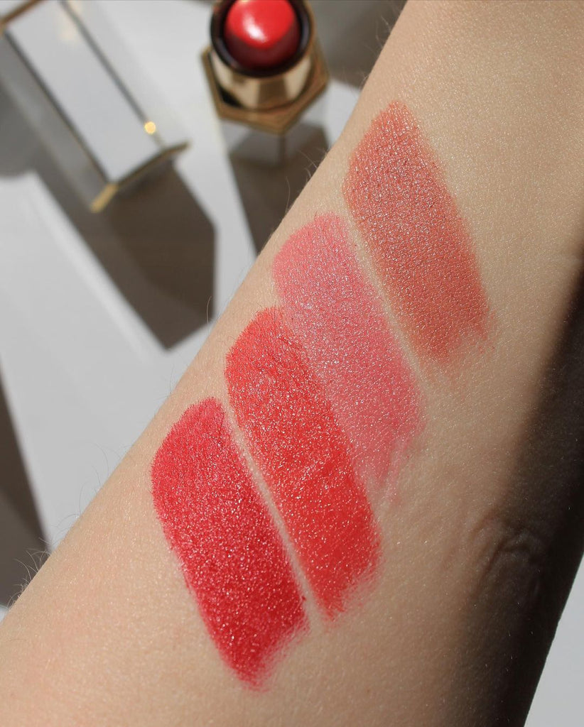 saint cosmetics velvet lip creme, matte lipsticks hand swatches. From top to bottom are Barcelona - a creamy nude, Dubai - soft pink, Singapore - orange red, and New York - classic red. Very pigmented and long wearing.