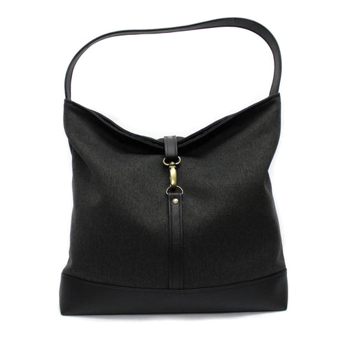 black fabric hobo shoulder bag with a clasp and black vegan leather bottom