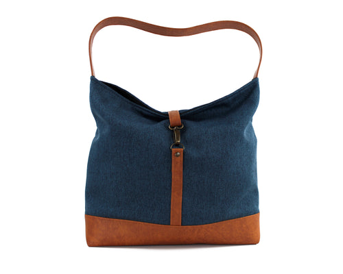 blue fabric hobo bag with clasp closure and brown vegan leather bottom