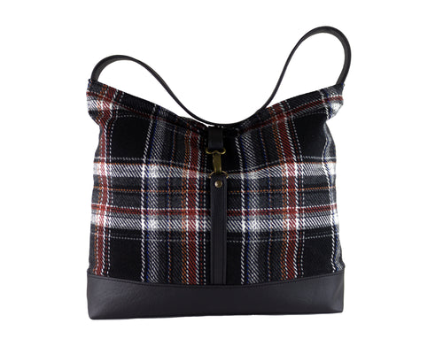 black plaid with brown, white and red pattern slouchy shoulder bag with clasp closure and vegan leather bottom